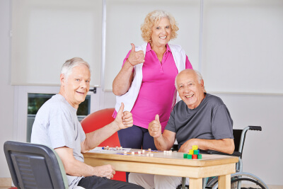 three senior people playing Bingo